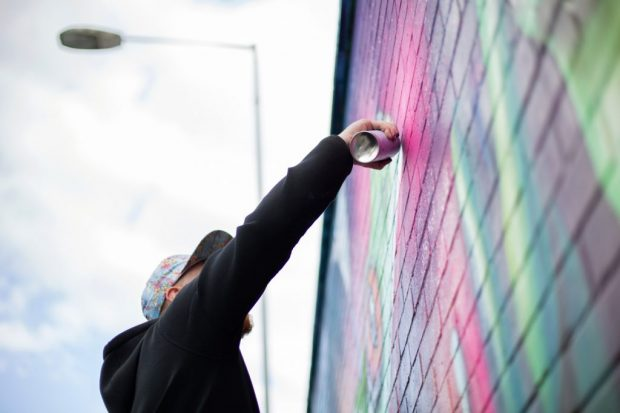 Street Artist @mickmowgli bringing his vision to life. Brighton 2019. By Ashley Laurence, Time for Heroes Photography